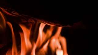 Flames burning fire wood at night slow motion