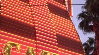 Flashing Casino sign in gambling city tilt establishing shot 4k
