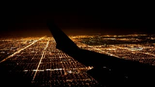Flying over City at Night