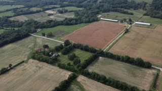 Flying over farm land aerial view