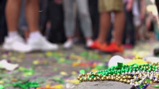 Focus Beads on floor of Bourbon street during Mardi Gras