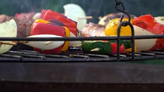 Food cooking on hanging fire pit grill 4k