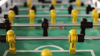 Foosball table men moving