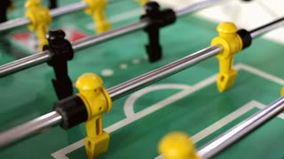 Foosball table with ball rolling