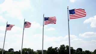 Four Flags in a row blowing in wind