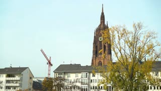 Frankfurt Cathedral in downtown of city establishing shot 4k