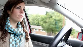Front view of Girl Driving car