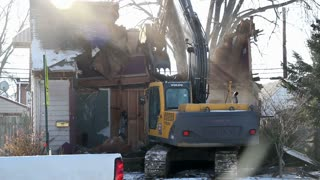 Front View of house being demolished