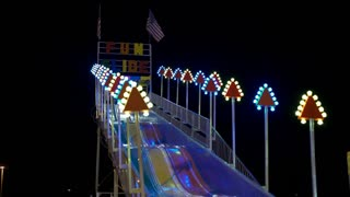 Fun Slide Carnival ride at night flashing 4k