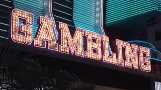 Gambling flashing sign at hotel and casino 4k