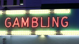 Gambling neon light with flashing lights