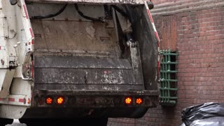 Garbage truck compacting trash 4k