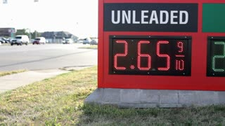 Gas prices at Station next to road