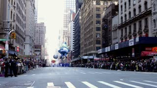 Gazer the Elf going down street with large crowds