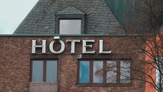 Generic Hotel sign on building 4k