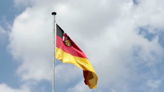 German flag blowing on clouded background