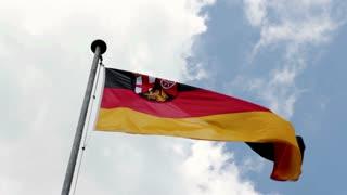 German flag in wind on blue sky