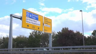 German Highway exit sign for Hanau with cars going by 4k