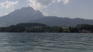 Giant mountain in Switzerland behind water