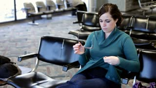 Girl cleans glasses in waiting area