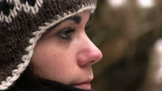 Girl in cold with hat close up