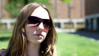Girl in Sunglasses on Bright Sunny Day