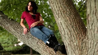 Girl laying on Tree Branch