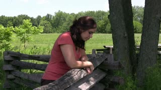Girl leaning on Wooden fence outdoor