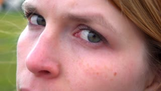 Girl looking at camera with green eyes slow motion