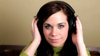 Girl looking at camera with Headphones on