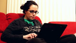 Girl on Couch using Laptop