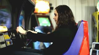 Girl Playing Racing Arcade Game