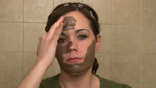 Girl Puts on Chocolate Face Masque