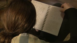 Girl Reading Journal on Couch