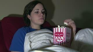 Girl Watching TV Eating Popcorn