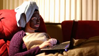 Girl with Chocolate Masque on Computer