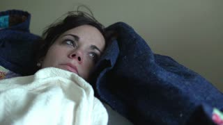 Girl with flu laying on couch sick