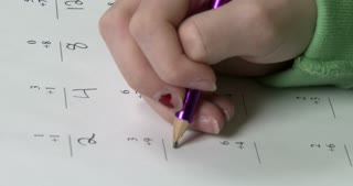 Girl working on math worksheet 4k