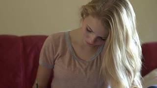 Girl works on homework tilt to paper shot 4k