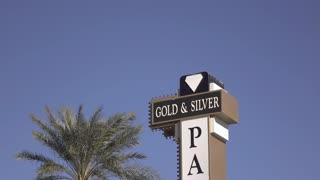 Gold and Silver exterior sign tilt shot 4k