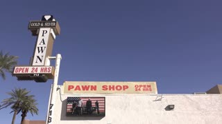 Gold and Silver Pawn shop wide angle establishing shot 4k
