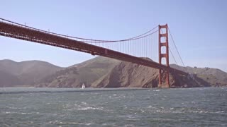 Golden Gate bridge from water below slow motion