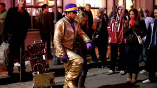 Golden man dancing on bourbon street