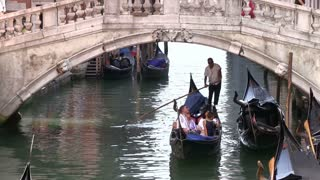 Gondola going under bridge