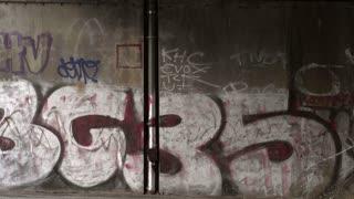 Graffiti wall in downtown Berlin pan shot