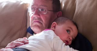 Granddaughter laying on grandpas chest 4k
