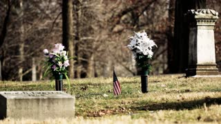 Grave with flowers and American flag