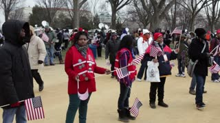 Group of people passing out flags at 2013 inauguration
