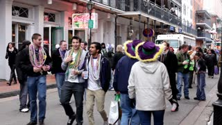 Group of People walking down Bourbon Street