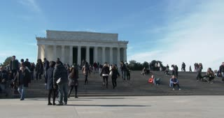 Groups of people sitting on steps at Lincoln Memorial 4k